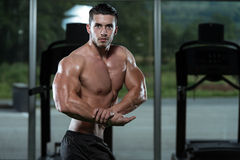 Man Bodybuilder Performing Side Chest Pose Stock Image