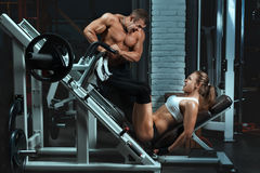 Man bodybuilder trains the a woman. Stock Image