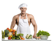 Man bodybuilder in white toque blanche and cook protective apron Stock Image