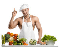 Man bodybuilder in white toque blanche and cook protective apron Stock Photography