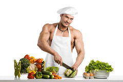 Man bodybuilder in white toque blanche and cook protective apron Stock Photo