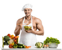 Man bodybuilder in white toque blanche and cook protective apron Royalty Free Stock Photography