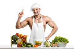 Man bodybuilder in white toque blanche and cook protective apron Stock Images