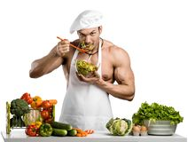 Man bodybuilder in white toque blanche and cook protective apron Royalty Free Stock Photos