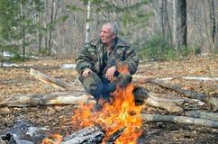 Man at bonfire 1 Stock Photo