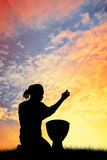 Man with bongos at sunset Royalty Free Stock Photography