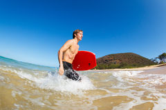 Man with Boogie Board at the Beach Stock Image