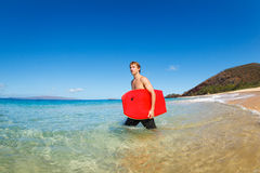 Man with Boogie Board at the Beach Royalty Free Stock Photography