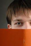 Man and book Stock Photos