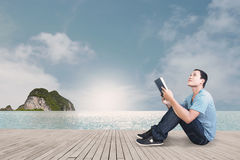 Man With Book Concept. Reading On The Beach Stock Image