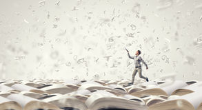 Man with book in hand Royalty Free Stock Photos