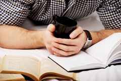 Man with a book in his bed. Royalty Free Stock Image