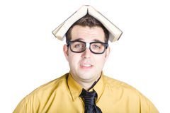 Man with book on his head Royalty Free Stock Photo
