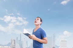 Man With Book Looking Up Above Stock Images