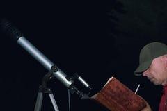 Man With Book Near Telescope Royalty Free Stock Photo