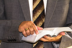 Man in suits and a book Royalty Free Stock Photos