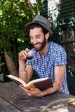 Man book relaxing outdoors Stock Photos