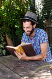 Man book relaxing outdoors Royalty Free Stock Photos