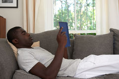 Man book sofa couch Royalty Free Stock Photo