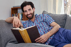 Man book sofa couch portrait Royalty Free Stock Photography