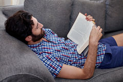 Man book sofa couch Royalty Free Stock Photography