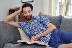 Man book sofa couch Stock Photography