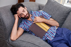 Man book sofa couch sleeping Royalty Free Stock Photos