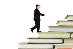 Man and book stairs. Isolated on white background royalty free stock photography