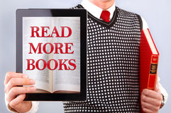 Man with book and tablet Royalty Free Stock Photography