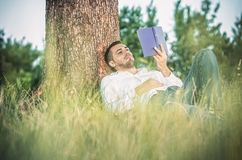 Man with book Stock Images