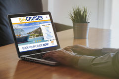 Man Booking Cruise Travel By Internet With A Laptop Royalty Free Stock Photography