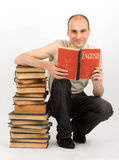 Man with books. Gray background stock photo