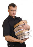 Man with books. Young man with stack of books Stock Image