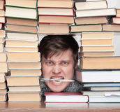 Man between books Royalty Free Stock Image
