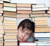 Man between books Stock Photography