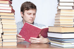 Man between books Stock Images