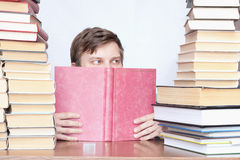 Man between books Royalty Free Stock Photography