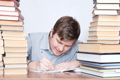 Man between books Royalty Free Stock Images