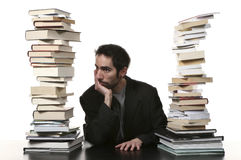 Man and books Stock Images