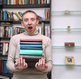 Man with books in the hands shocked Royalty Free Stock Photo