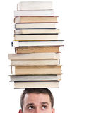 Man with books on his head Stock Photo