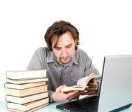 Man with books and laptop. Isolated Royalty Free Stock Image