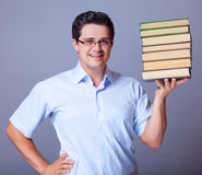 Man with books. Stock Images