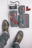 Man boots with valentines gifts box and old camera. Hipster ornaments. Stock Photography
