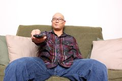 Man bored watching TV Stock Image
