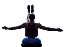 Man bosu balance trainer  exercises fitness silhouette Stock Image
