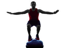 Man bosu balance trainer  exercises fitness silhouette Stock Images