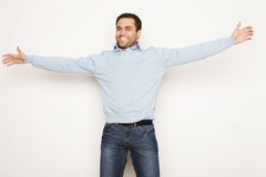 Man with both hands raised in the air. Royalty Free Stock Photos