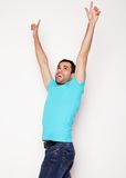 Man with both hands raised in the air. Stock Image