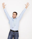Man with both hands raised in the air. Royalty Free Stock Image
